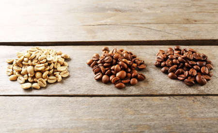 seeds of various: Coffee beans on wooden background