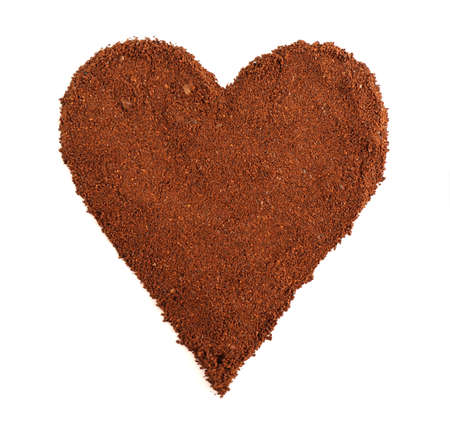 brewed: Ground coffee in shape of heart isolated on white