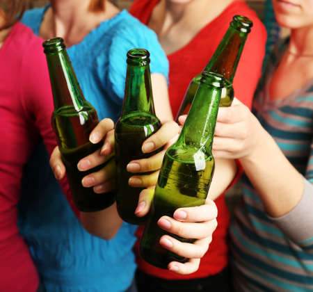 glass bottles: Beer in female hands, closeup