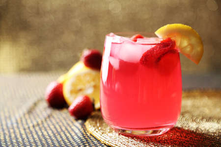 the strawberry: Glass of freshness lemonade with strawberries, on bright background Stock Photo