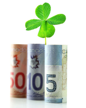 quarterfoil: Clover leaf and Canadian dollars on white surface