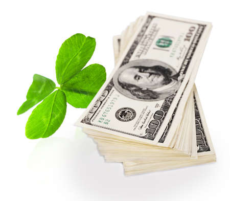 quarterfoil: Clover leaf and dollars on white surface
