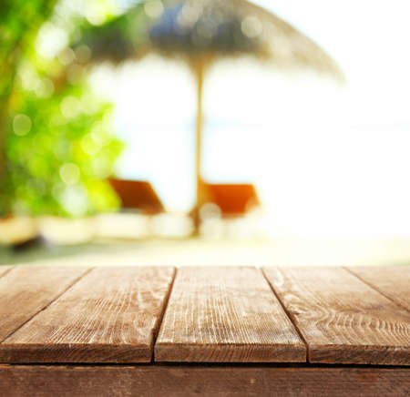 Wooden desk on beach background Stock Photo