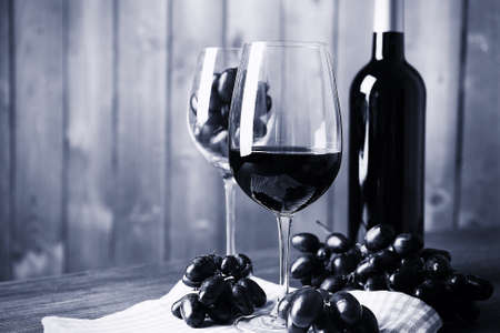 stylization: Beautiful still life with wine and grape,  black and white retro stylization Stock Photo