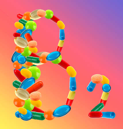 bright colour: B 2 made of different pills on bright colour background