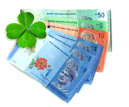 quarterfoil: Money banknotes with clover leaf isolated on white