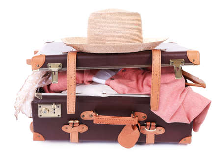 suitcase packing: Packing suitcase for trip isolated on white