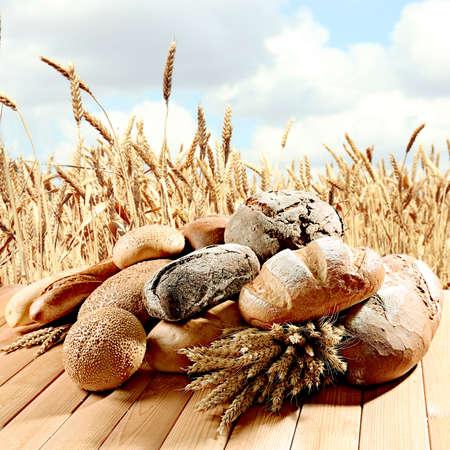 wheatfield: Fresh bread on wheatfield background Stock Photo