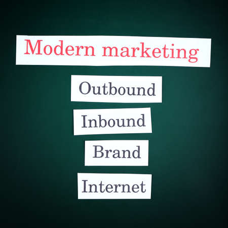 outbound: Themed keywords on green blackboard background Stock Photo