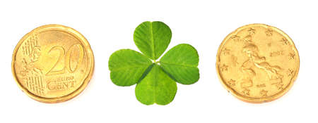 quarterfoil: Euro coins and clover leaf isolated on white Stock Photo