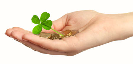 quarterfoil: Clover leaf and euro coins in hand isolated on white