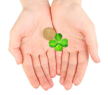 quarterfoil: Clover leaf and euro coin in hand isolated on white Stock Photo