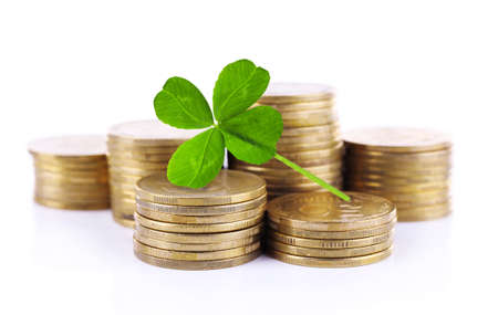quarterfoil: Clover leaf and stacks of coins isolated on white