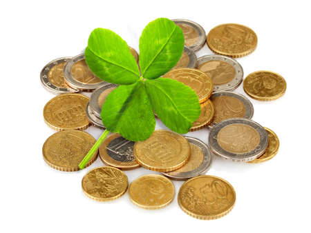 quarterfoil: Clover leaf and euro coins isolated on white
