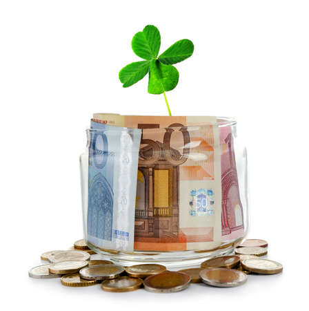quarterfoil: Clover leaf and money isolated on white