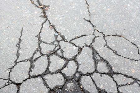 asphalt paving: Cracked asphalt close up