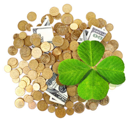 quarterfoil: Clover leaf, golden coins and dollars on white surface