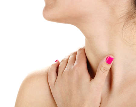 enhanced health: Young woman with neck pain close up