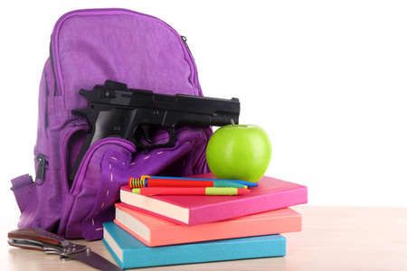 bookbag: Gun in school backpack, isolated on white Stock Photo
