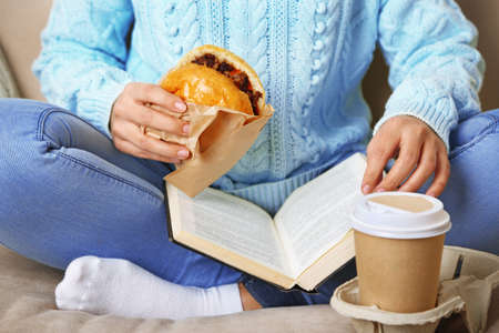 fat food: Woman with unhealthy fast food, close-up Stock Photo