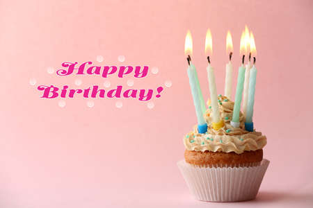birthday cupcake: Birthday cupcake with candles on color background Stock Photo