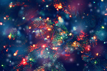 abstract light: Christmas tree decorated with garlands, close-up