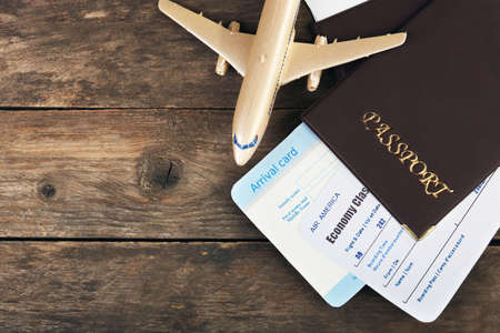 airplane ticket: Airline tickets and documents on wooden background