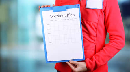 entries: Sports trainer with personal workout plan Stock Photo
