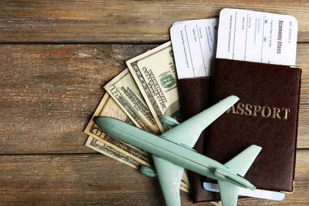 flight ticket: Airline tickets and documents on wooden table, top view