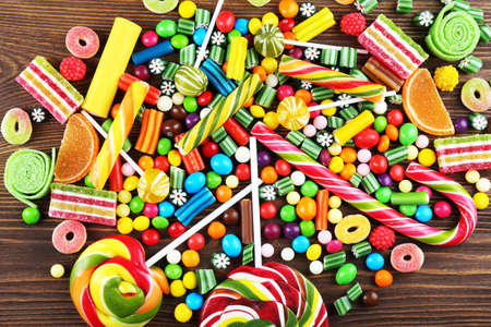 bright colors: Colorful candies on wooden background