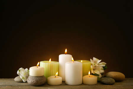 candle: Beautiful composition with candles and spa stones on dark background