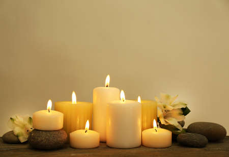 spa flower: Beautiful composition with candles and spa stones on light background