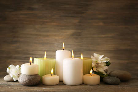 spa: Beautiful composition with candles and spa stones on wooden background