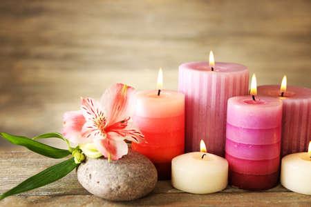alstroemeria: Candles with alstroemeria close up Stock Photo