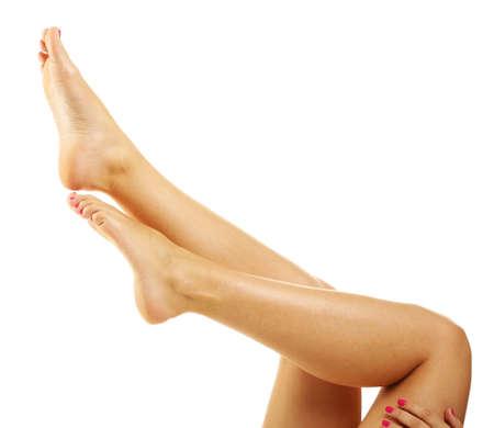 partes del cuerpo humano: Hermosas piernas femeninas, aisladas sobre fondo blanco Foto de archivo