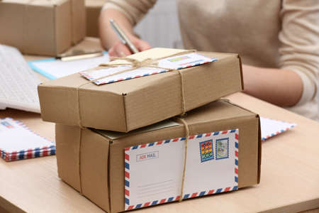 parcel service: Cardboard boxes on work place in post office