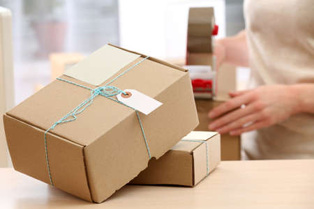 Woman packs parcel in post office