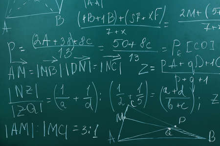 trigonometry: Maths formulas on chalkboard background