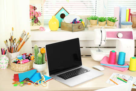 home office interior: Beautiful comfortable seamstress workplace