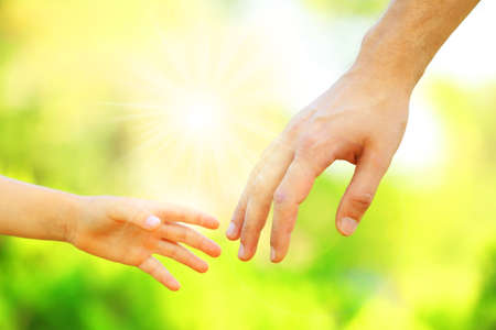 kids holding hands: Hands of father and son holding each other Stock Photo