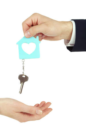 trinket: Male hand giving key with trinket to female hand isolated on white