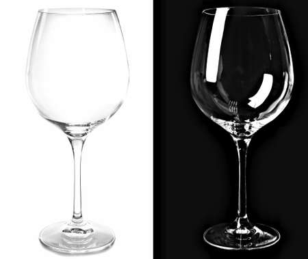 bar ware: Two empty wine glasses, isolated on black and white backgrounds Stock Photo
