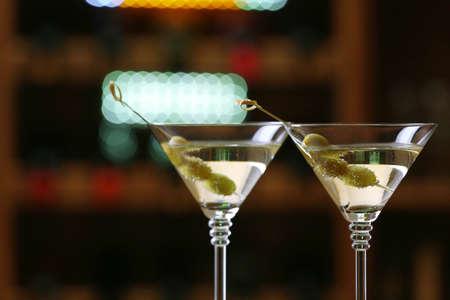 bar: Glasses of cocktails on bar background
