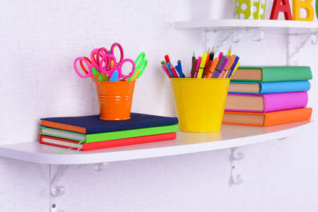 color pencils: Shelves with stationery in child room close-up