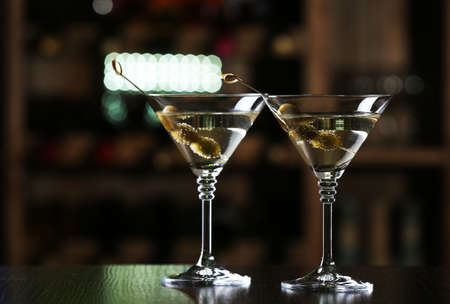 martini: Glasses of cocktails on bar background
