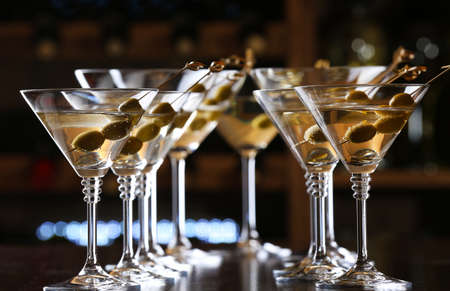 nightclub party: Glasses of cocktails on bar background