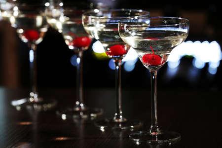 nightclub bar: Glasses of cocktails on bar background