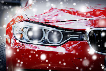 Headlights of red car over snow effect Stock Photo