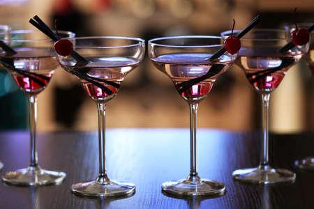 drinks on bar: Glasses of cocktails on bar background