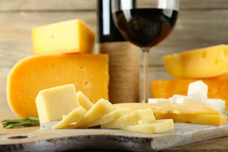chees: Various types of cheese with wine on table close up Stock Photo